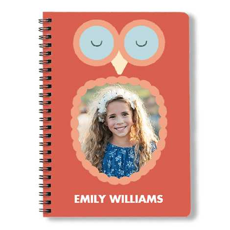 Owl framed spiral book with a girl's face.