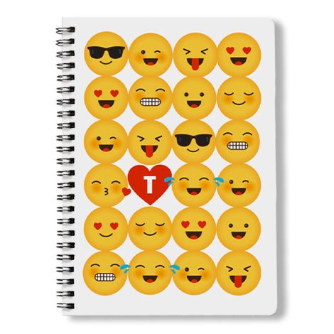 Spiral book with emoji cover on it.