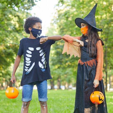 Two children in Halloween fancy dress